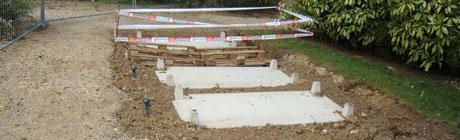 chantier de pose dalle engazonnée pour cimetière paysager avec caveau monobloc Stradal